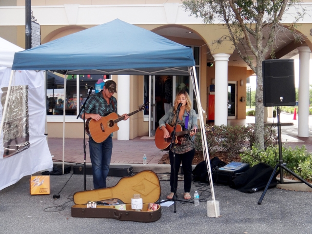 Jay Taylor and Mandy McMillan performing at Saturday's Farmer's Market on Main Street.