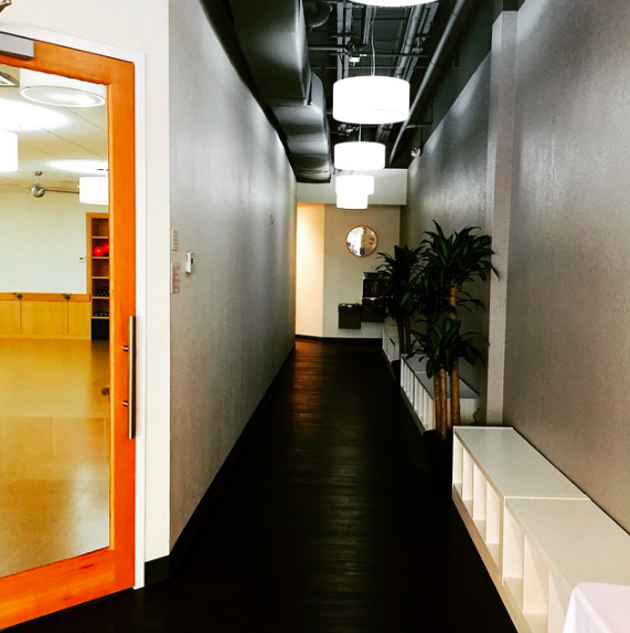 Barre3 Lakewood Ranch Instagram: A hallway with cubbies that leads to the studio, shower facility and lockers.